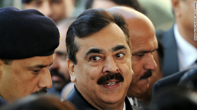 Pakistani Prime Minister Yousuf Raza Gilani, center, arrives at the Supreme Court in Islamabad on January 19.