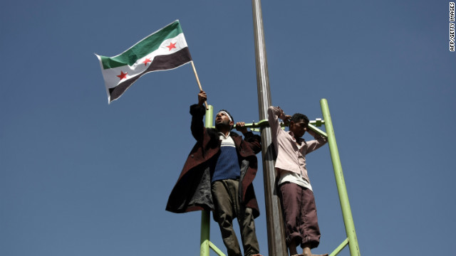A Yemeni anti-government protester waves a pre-Baath Syrian flag during a rally in solidarity with the Syrian people in Sanaa.