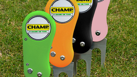 """Available in pink, red, blue, orange, green or black, makers CHAMP say the """"ping"""" noise the prongs make as they spring forth on these new divot repairers will thrill you!"""
