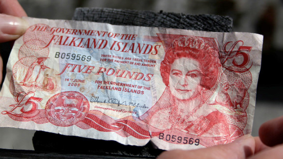 A Falklands Five pound note issued by the Falkland Islands Government; the disputed islands, which Argentina calls Las Malvinas, are viewed by Britain as a British Overseas Territory, like Bermuda or Gibraltar.