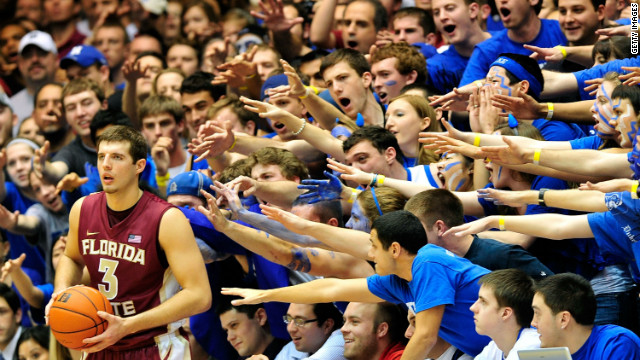 At Cameron Indoor Stadium, Duke fans do their best to distract players on the opposing team.