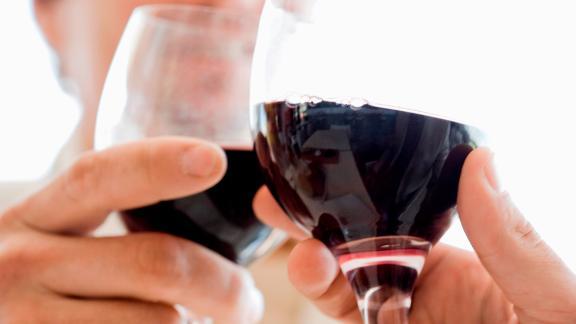 Two people enjoying a few glasses of wine.