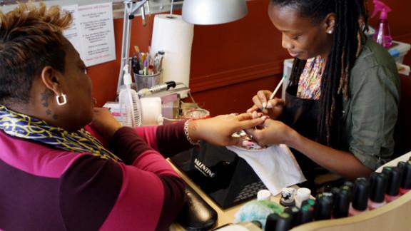 "Tashina ""Poochie"" Green says she creates works of art on her customers' nails."