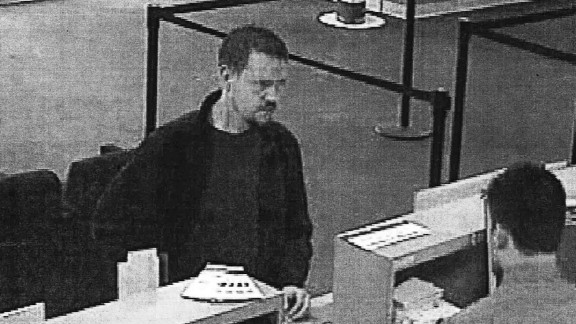 A surveillance photo shows Josh Powell at a Puyallup bank the day before the alleged murder-suicide.