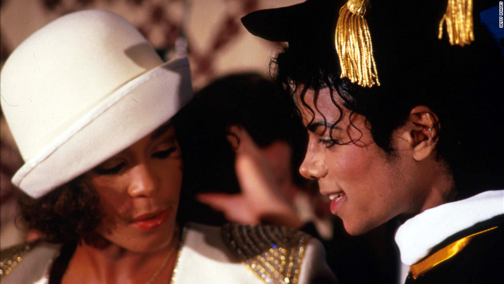 Whitney Houston stands with pop legend Michael Jackson in March 1988 in New York as Jackson receives an honorary Doctor of Humane Letters degree from the United Negro College Fund. Houston's sudden death at age 48 shocked fans and musicians all over the world.