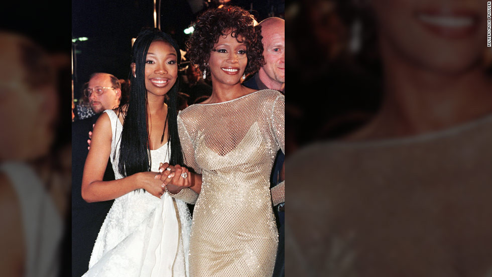 "Singer-actress Brandy poses with Houston at the premiere of their made-for-television movie ""Cinderella"" in October 1997 in Hollywood."