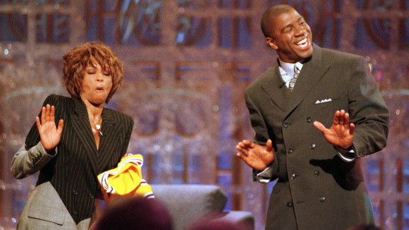 Basketball legend Magic Johnson and Houston dance during the taping of the 1998 premier of Johnson