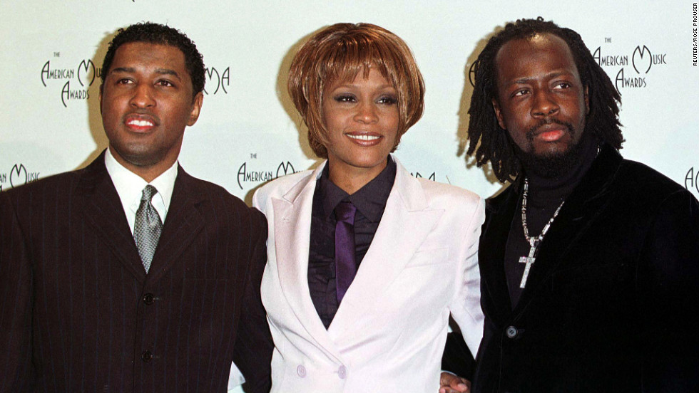 "Kenneth ""Babyface"" Edmonds, left, Houston and Wyclef Jean pose for photographers after performing at the 26th annual American Music Awards in January 1999 in Los Angeles."