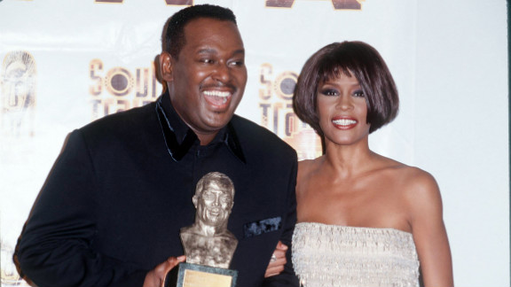 Singer Luther Vandross and Houston pose for photographers in March 1999.