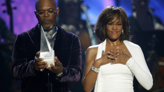 Houston reacts to receiving the International Artist of the Year award while actor Samuel L. Jackson presents the award  at the 2009 American Music Awards in Los Angeles.