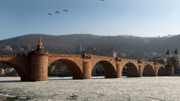 The castle and the old bridge are seen over the frozen river Neckar in Heidelberg, southwestern Germany, on February 12, 2012. Temperatures remain cold in Germany as the death toll from Europe