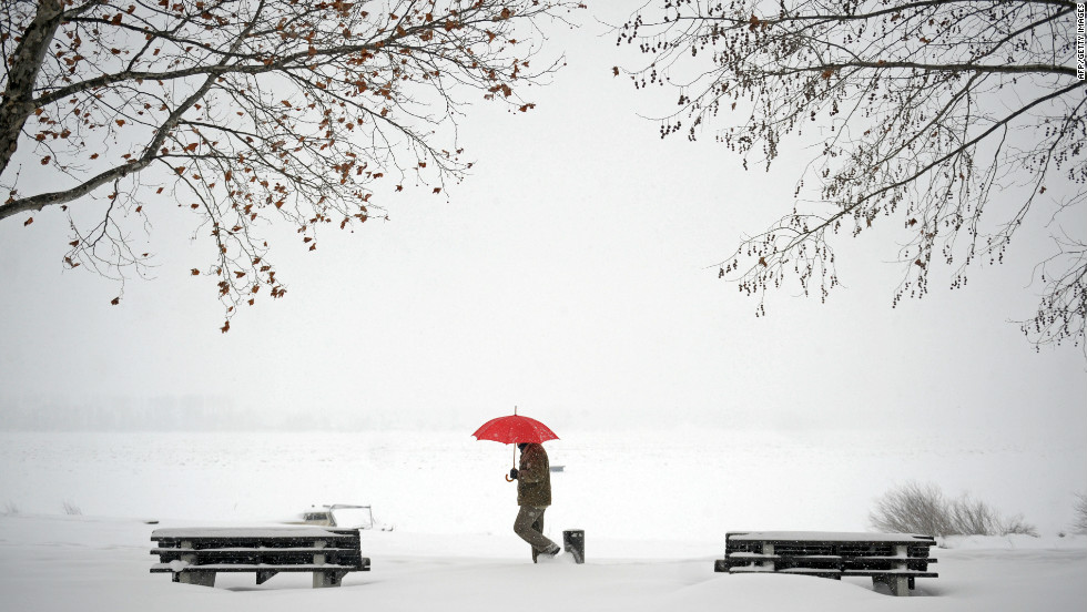 A man walks through snow covered banks of the Danube river in Zemun near  Belgrade on
