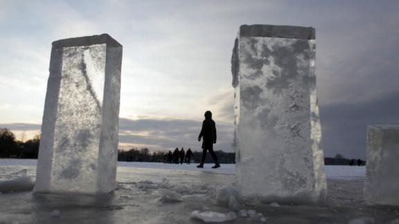 People walk on the frozen lake Zwischenahner Meer in Bad Zwischenahn, near Oldenburg, northern Germany, where blocks of ice have been cut out.