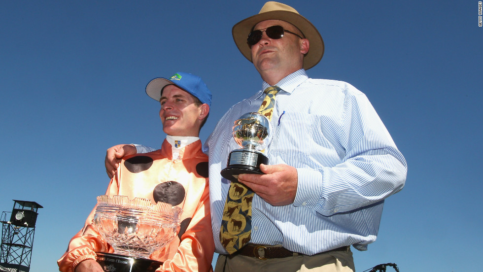 Jockey Luke Nolen, left, rode Black Caviar to yet another win at Caulfied Racecourse in Melbourne. He is pictured here alongside trainer Peter Moody.