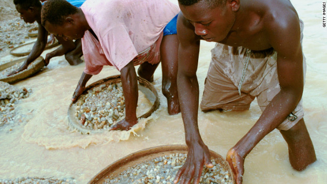 Workers pan for diamonds in a government-controlled diamond mine near Kenema, Sierra Leone, in 2001.