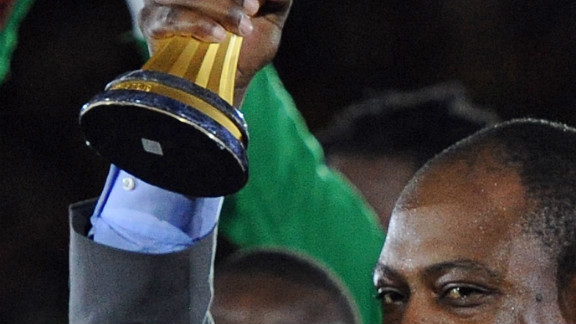 Former Zambia player Kalusha Bwalya holds the Africa Cup of Nations aloft after the Copper Bullets beat Ivory Coast in Sunday