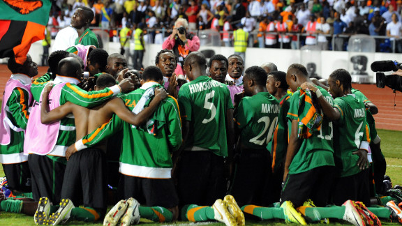 The Zambia team gather together in prayer moments after Stoppila Sunzu