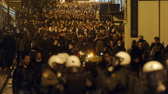 Protesters clash with riot police near the Greek parliament in Athens