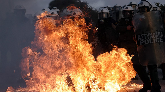 A riot police is engulfed by flames during clashes with protestors in Athens on February 12. Greek police used tear gas on petrol bomb-throwing protesters outside parliament where lawmakers were debating a new austerity plan aimed at staving off bankruptcy.