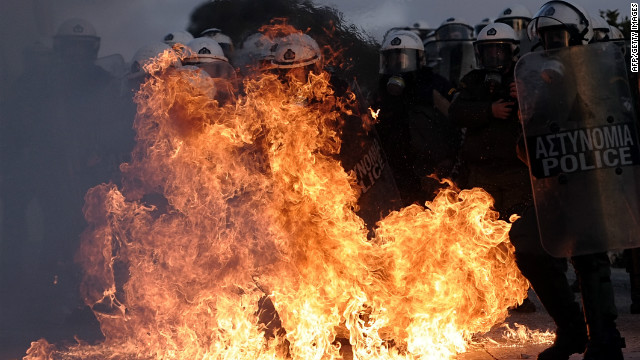A riot police is engulfed by flames during clashes with protestors in Athens on February 12, 2012. Greek police today used tear gas on petrol bomb-throwing protesters outside parliament where lawmakers were debating a new austerity plan aimed at staving off bankruptcy. AFP PHOTO / ARIS MESSINIS (Photo credit should read ARIS MESSINIS/AFP/Getty Images)