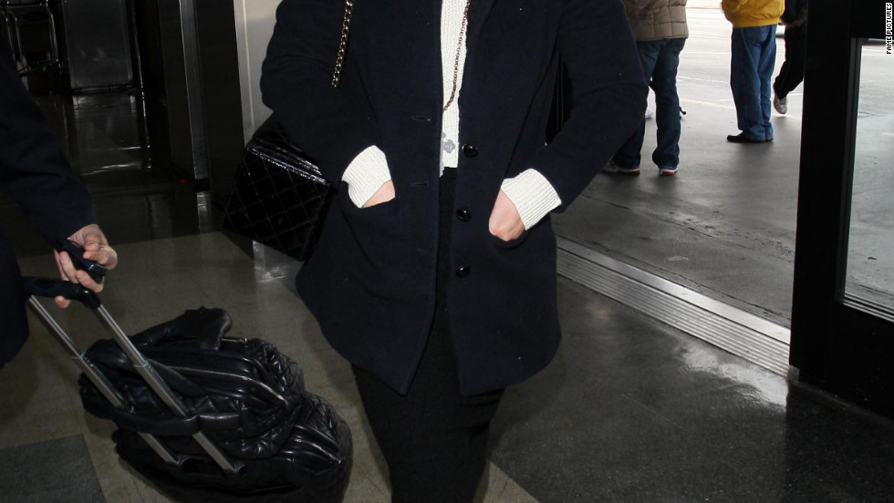 Kelly Osbourne catches a flight from Los Angeles.