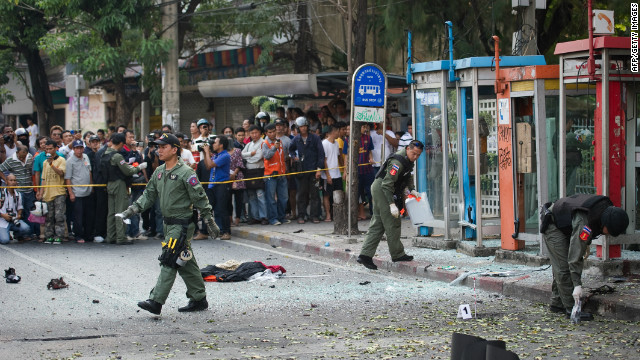 Thai bomb squad officials look at the site of an explosion in Bangkok on Tuesday.
