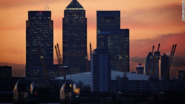 The sun sets behind the London skyline. Ratings agency Fitch puts the UK economy on negative watch.