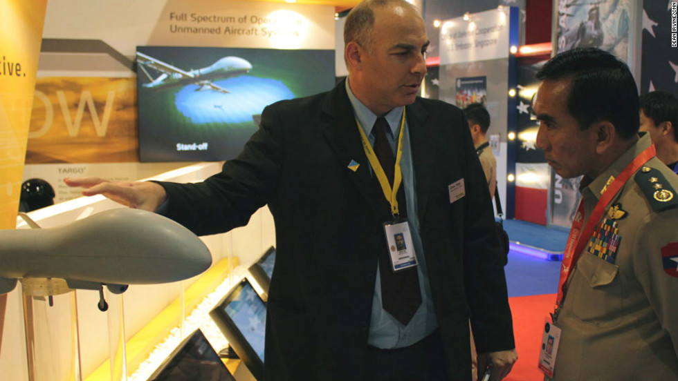 The not so hard sell: A representative from Israeli defence company Elbit Systems introduces its collection of UAVs to a Singaporean military officer.