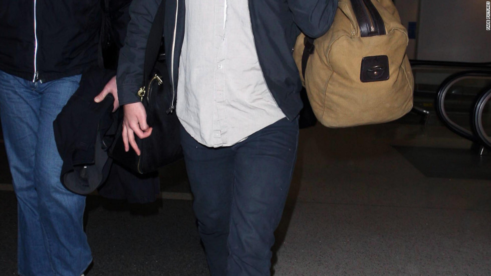 Robert Pattinson arrives in Los Angeles.