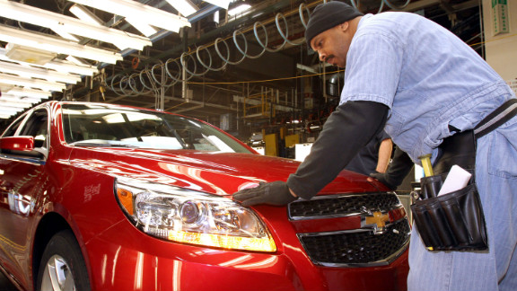 In this handout provided by General Motors, employee Maurice Vauss inspects the fit and finish of the 2013 Chevrolet Malibu Eco during final inspection on the assembly line in preparation for the Malibu's rollout to dealers across the U.S. at the General Motors Fairfax Assembly Plant January 18, 2012 in Fairfax, Kansas.