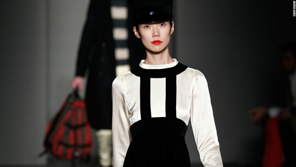 This Marc Jacobs ensemble showcases a black-and-white contrast and a fitted military style, both of which have appeared in many of the fall 2012 collections.