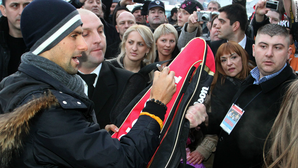 Djokovic, seen here signing autographs for fans in Jagodina, is a national hero in Serbia.