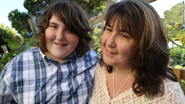 Cory, 15, seen here with his mother, Nicole Seguin, credits his family for supporting him.