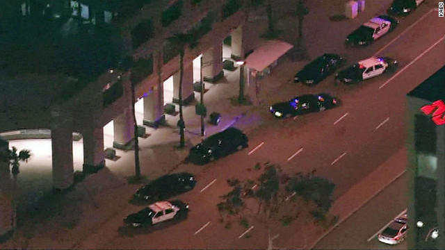 Police cars sit outside the ICE offices in Long Beach, California, after a shooting on Thursday.