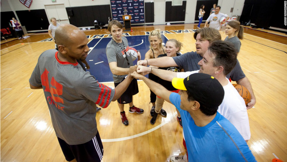 The 'Lucky 7' and Dr. Sanjay Gupta do a 'hard work' shoutout with Atlanta Hawks' Jerry Stackhouse before a practice workout on the teams' court