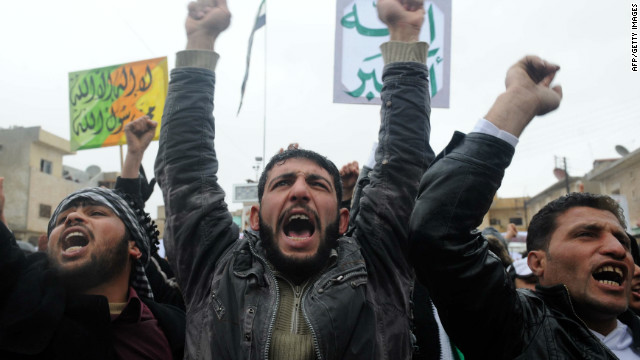Syrians demonstrate against the regime after Friday prayers in the north Syrian city of Idlib on February 17. Activists working against the regime now have to worry about malware that can expose their activities.