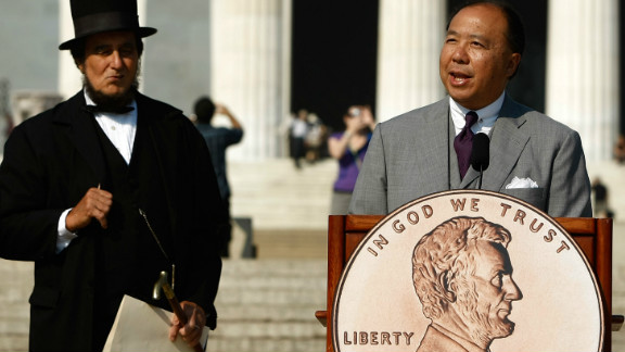A ceremony for a newly designed penny is held in 2009. Robert Whaples says it