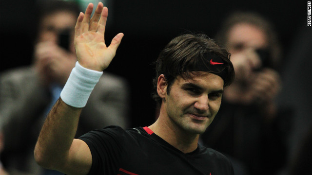 Roger Federer waves to the crowd after defeating Jarkko Nieminen in Rotterdam