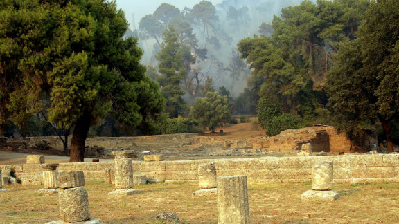 Ancient Olympia in Greece, pictured here in 2007 during a spate of brush fires, is the site of the original Olympic Games.