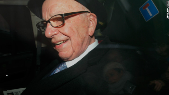 News Corporation Chief Rupert Murdoch leaves his London home to visit the offices of his British tabloid The Sun on February 17