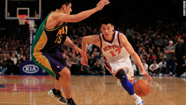 Jeremy Lin of the New York Knicks drives against Gustavo Ayon of the New Orleans Hornets on February 17, 2012.