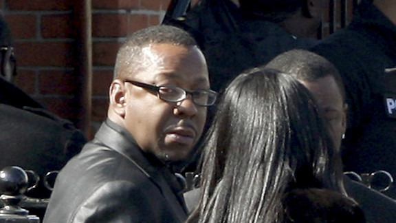 Bobby Brown, left, outside the funeral of his ex-wife, Whitney Houston. Brown later left abruptly.