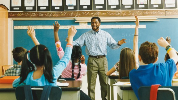 Teacher with students in classroom