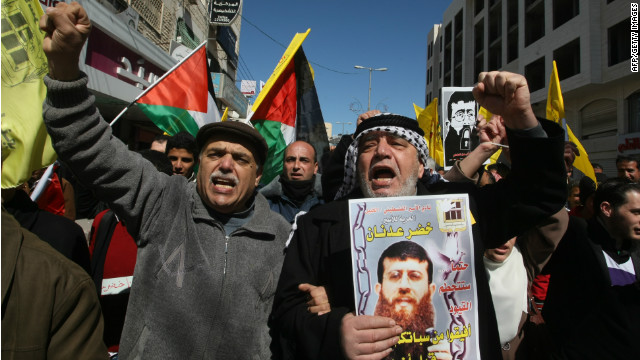 Palestinians rally in support of Khader Adnan shortly before Adnan ended his 66-day hunger strike on February 21, 2012.