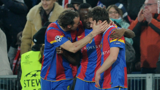 Basel players mob Valentin Stocker after he scored the only goal of the match against Bayern Munich