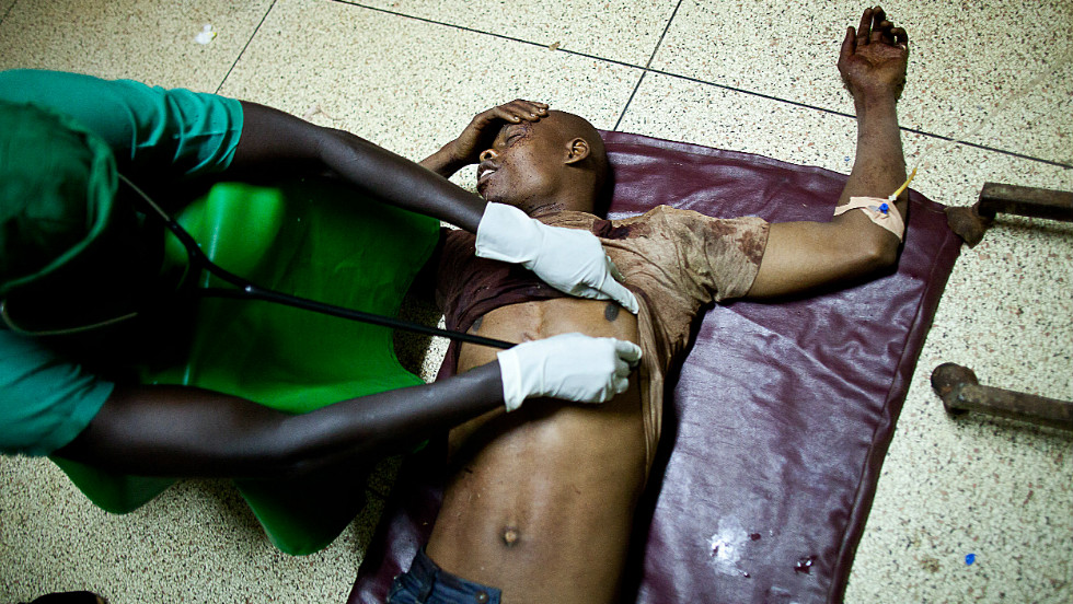 Al-Shabaab factions have carried out what appeared to many Somalis as senseless attacks. Here, a doctor treats a victim at Mulago hospital in Kampala late on July 11, 2010 after twin bomb blasts tore through crowds of football fans watching the World Cup final, killing 64 people, including an American, and wounding scores of others.