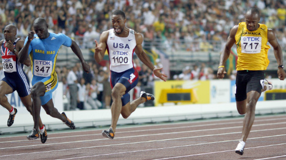 But Gay stormed to gold in the 100m, beating Derrick Atkins of the Bahamas (left) and Jamaica