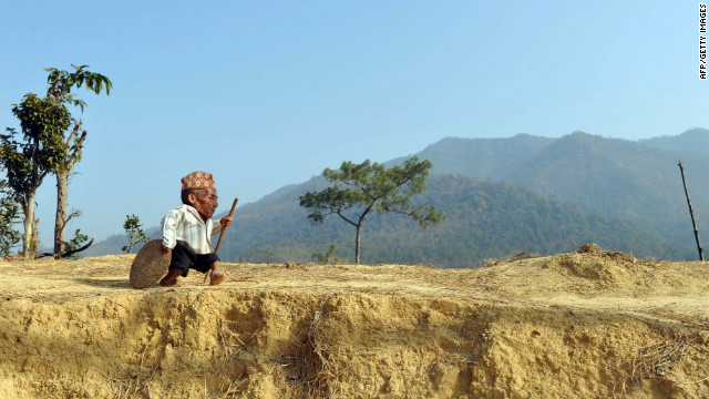 Chandra Bahadur Dangi, a 72-year-old Nepali, walks near his home in the village of Reemkholi.
