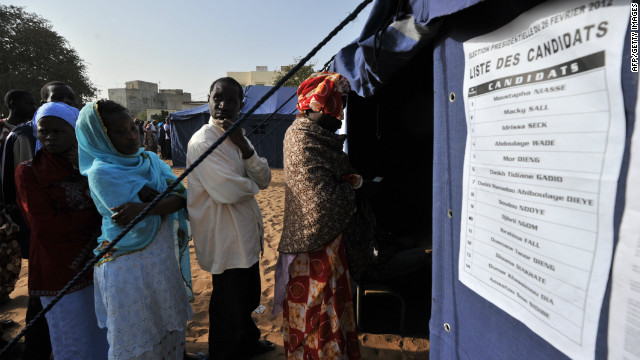 Senegalese voters line up to cast ballots Saunday in Dakar, Senegal.