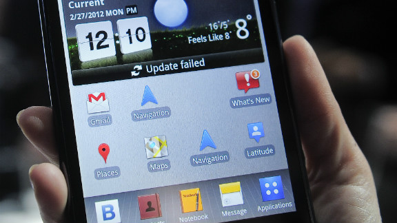 A hostess holds a LG Optimus Vu, which boasts one of the biggest screens seen on a smartphone.